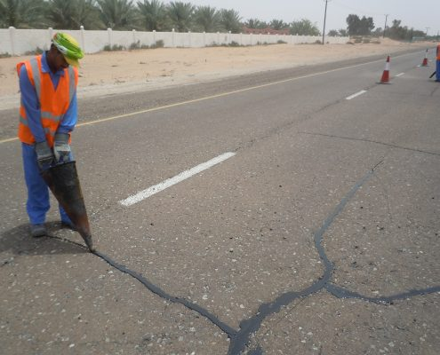 Sealant application to asphalt crack by cone